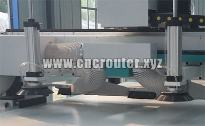 Suction cup load device for automatic loading cnc router